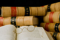 Law Books. Old law books and antique spectacles. Shallow depth of field Stock Photo