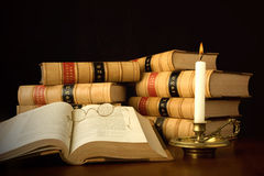 Law books by Candlelight. Old law reports and spectacles by candlelight Stock Photo