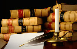 Law books by Candlelight. Law reports, quill pen and candle Stock Photo
