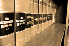 Law Books on Job Discrimination. Close up of several volumes of law books of codes and statutes on job discrimination Royalty Free Stock Photos