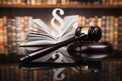 Law books, Paragraph justice concept, Court gavel. Law theme, mallet of the judge, justice scale, books, wooden desk stock photo