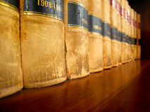 Law Books on Shelf. Row of old leather law books on a shelf Stock Image