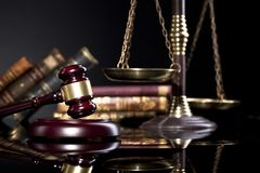 Scale of justice and judge`s mallet on black backgrund Stock Photo