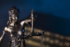 Law theme. Blind justice symbol - Themis. Law code. Statue of justice and  books. Blue background. Place for text Stock Photos