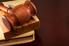 Law compliance. The gavel of justice and a pen lying on the book Royalty Free Stock Photos