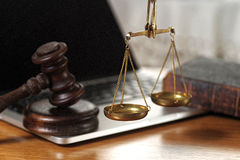 Law composition. With scale and gavel on  old brown leather book Royalty Free Stock Image