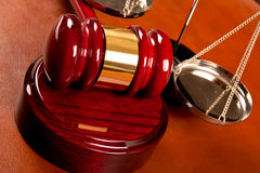 Law concept. Gavel and scales of justice Stock Photos