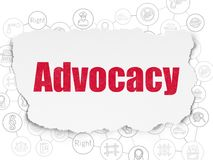 Law concept: Advocacy on Torn Paper background Royalty Free Stock Photos