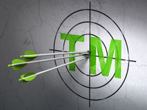 Law concept: arrows in Trademark target on wall background. Success law concept: arrows hitting the center of Green Trademark target on wall background, 3d Royalty Free Stock Images