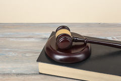 Law concept - Book with wooden judges gavel on table in a courtroom or enforcement office.Copy space for text. Stock Image