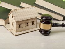 Law concept - Books, model house with wooden judge gavel on table .Copy space for text