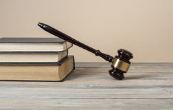 Law concept - Books with wooden judges gavel on table in a courtroom or  enforcement office.Copy space for text. Royalty Free Stock Image