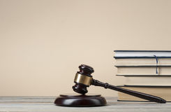 Law concept - Books with wooden judges gavel on table in a courtroom or  enforcement office.Copy space for text. Stock Photo
