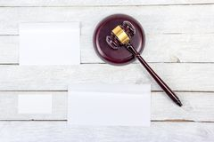 Law concept. Business card. Corporate stationery set mockup. Blank textured brand ID elements on wooden table, gavel. Law concept. Corporate stationery set Royalty Free Stock Photography