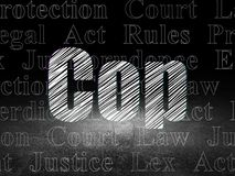 Law concept: Cop in grunge dark room Royalty Free Stock Photography