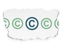 Law concept: copyright icon on Torn Paper Royalty Free Stock Photos