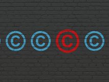 Law concept: copyright icon on wall background Stock Photo