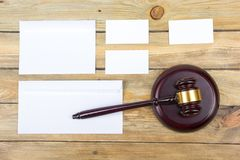 Law concept. Business card. Corporate stationery set mockup. Blank textured brand ID elements on wooden table, gavel. Law concept. Corporate stationery set Royalty Free Stock Photos