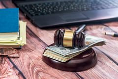 Gavel, laptop, dollar on desk. Law concept - gavel, laptop, dollar on desk Stock Images