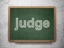 Law concept: Judge on chalkboard background Royalty Free Stock Image