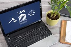 Law concept on a laptop. Laptop screen with law concept stock image