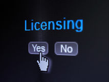 Law concept: Licensing on digital computer screen. Law concept: buttons yes and no with pixelated word Licensing and Hand cursor on digital computer screen Royalty Free Stock Photos