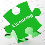 Law concept: Licensing on puzzle background Stock Photo