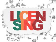 Law concept: Licensing on Torn Paper background Royalty Free Stock Photos