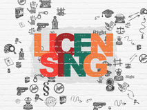 Law concept: Licensing on wall background Royalty Free Stock Image