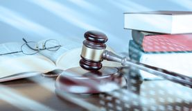 Law concept; light effect. Judge gavel with law books; light effect royalty free stock image