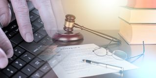 Law concept; multiple exposure. Judge gavel with contract (random english dummy text used); multiple exposure royalty free stock photo