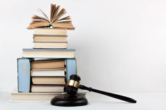 Law concept open book with wooden judges gavel on table in a courtroom or law enforcement office, white background. Copy Stock Photo