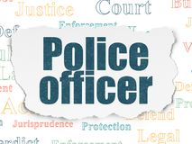 Law concept: Police Officer on Torn Paper background Royalty Free Stock Image