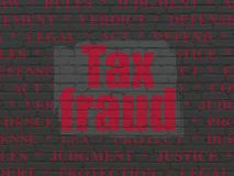 Law concept: Tax Fraud on wall background Stock Photography