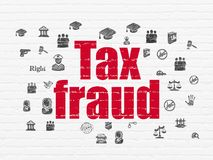Law concept: Tax Fraud on wall background Stock Image