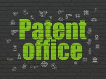 Law concept: Patent Office on wall background Stock Images