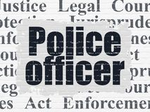 Law concept: Police Officer on wall background stock photo