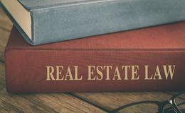 Real estate law. Law concept, real estate law books, antiquarian books pile on wood table Royalty Free Stock Photos