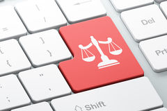 Law concept: Scales on computer keyboard background Stock Images
