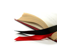 The Law. Law concept stock image. Silk ribbons on a opened legal book against a white background. Copy space Royalty Free Stock Photo