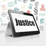 Law concept: Tablet Computer with Justice on display Royalty Free Stock Photo