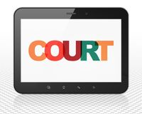 Law concept: Tablet Pc Computer with Court on  display Stock Images