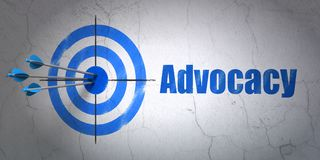 Law concept: target and Advocacy on wall background. Success law concept: arrows hitting the center of target, Blue Advocacy on wall background, 3D rendering Royalty Free Stock Photos