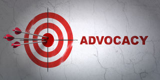Law concept: target and Advocacy on wall background. Success law concept: arrows hitting the center of target, Red Advocacy on wall background, 3D rendering Royalty Free Stock Image