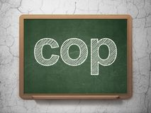 Law concept: Cop on chalkboard background Stock Images