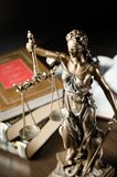 Law concept with Themis and books in background Stock Images