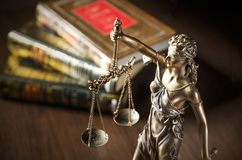 Law concept with Themis and books in background Royalty Free Stock Photography