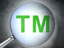 Law concept:  Trademark with optical glass. Magnifying optical glass with Trademark icon on digital background, 3d render Royalty Free Stock Photo