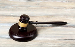 Law concept - wooden judges gavel on table in a courtroom or  enforcement office.Copy space for text. Stock Image