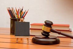 Law conceptual theme with gavel and law books in the background Royalty Free Stock Image
